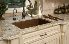 Golden Crystal Granite Countertops. Like the color of granite and cabinets.