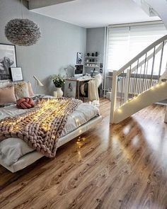 That chunky blanket looks so warm. Love the gray wall and pretty hardwood floor!