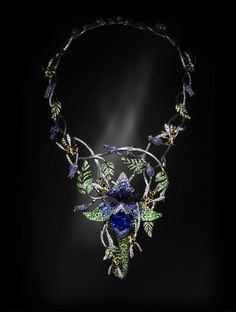 Wasp - sapphire, tsavorite and diamonds.  Necklace by Jack du Rose