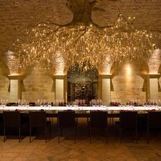 The subterranean tasting room at HALL Rutherford, built with limestone and reclaimed 19th century Austrian bricks, is situated directly below its Sacrashe Vineyard. More than 35 pieces of contemporary art are on display here, but the focal point is the eye-catching chandelier, representing a grapevine root system and accented with 1,500 Swarovski crystals. hallwines.com