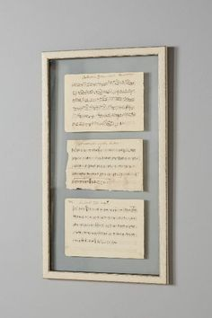 "Use old hymnal pages. Could ""antique"" page of a lullaby or wedding song.  Sheet Music Vintage Wall Art - anthropologie.com"