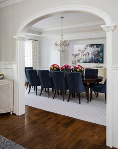 Elegant furniture, a stylish chandelier, an eye-grabbing piece of wall art...A sophisticated formal dining room   with a distinctive architectural character! #FormalDiningRooms