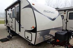 """2016 New Venture Sonic 220VRB Travel Trailer in Iowa IA.Recreational Vehicle, rv, 2016 Venture Sonic , Rear bath ultralight camper with a slideout and outside kitchen that is easily towable by smaller vehicles. For sale at Good Life RV., Furniture: 82"""" Interior Height, Ball Bearing Full Extention Drawer Glides, Cognac Maple Cabinet Doors and Drawers, Corner Shower, Designer Carefree Residential Freeze/Crack Proof Linoleum, Designer Padded Headboard, Flipside Cushions, Foot Flush Toilet, Hard…"""