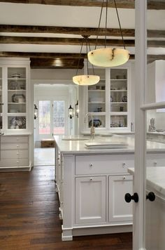 White kitchen with exposed beams. #art #architecture #design