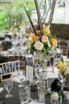 I love the soft yellow flowers and elegant linens @cedarwoodwed | DOVE Photography
