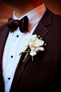 Black and white ribbon boutonniere | photography by http://www.amandahein.com/
