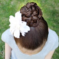 """""""4 strand braided bun with a rope twist on my daughter. With 5 kids and a career that takes up much of my time I am always on the lookout for styles that are quick and look more difficult than they really are. Braided buns are definitely one of my go-to styles - I love the way this one turned out! ❤"""" Photo taken by @thebraidparadenj on Instagram, pinned via the InstaPin iOS App! http://www.instapinapp.com (05/15/2015)"""