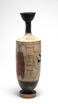 Oil flask (lekythos): a man and woman at a tomb.  The tall gravestone is decorated with sashes tied around it by the mourners.  Production place: Athens. Date: around  440 BC. Fired Clay, white-ground technique.