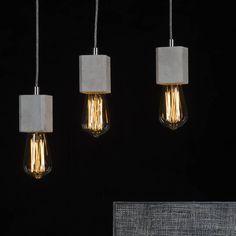 Our Kalla concrete lamps with edison vintage lightbulbs