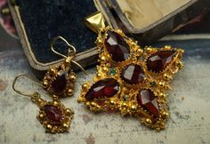 New. A Georgian pendant & earrings set with facades garnets. Shop link in our Instagram profile!