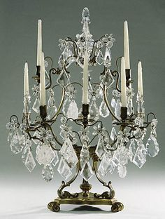 """1730 French Girandole (one of two) at the J. Paul Getty Museum, Los Angeles - From the curators' comments: """"Drops of rock crystal or glass were often included in lighting fixtures because they multiplied and fragmented the candlelight....A Parisian newspaper, the Mercure Galant, reported in 1677 about people's astonishment at the amount of light created as the candle flames reflected off the crystal."""""""