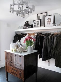 Build shelf and hanging bar into wall to make spare room a large closet!