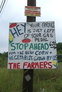 .I brake for Farmer's markets...I would especially stop for this one...Grown by us...The Farmers.....great sign...