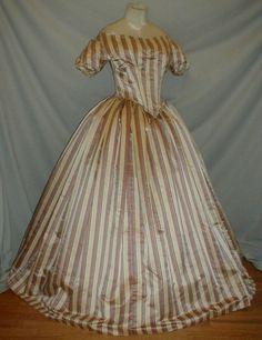 "Elegant 1850 1860 Stripe Satin Evening Dress | eBay seller fiddybee; burgundy & navy blue stipe; cream background; piped tab holds sleeves, piping at armscyes, sleeve hem, shoulders & waist; bodice & skirt lined in cotton; skirt attached w/ cartridge pleating; back hook & eye closure; bust: 34""; waist: 26""; skirt length: 42""; hem width: 146"""