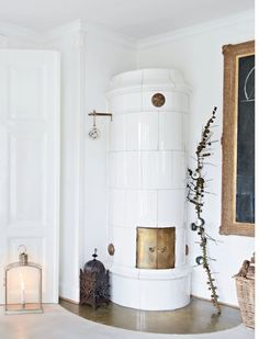 A DANISH FAMILY HOME IN CHRISTMAS STYLE | THE STYLE FILES love the fireplace