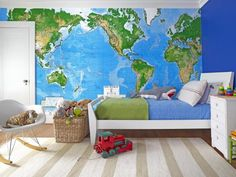 """The """"Oh, wow!"""" element in 7-year-old James' room is definitely the map wall: Hampton had a giant map (8 feet, 8 inches by 13 feet) cut to fit, then hung by a wallpaper installer. The other walls are painted Blueberry Hill by Benjamin Moore. The bed is from The Land of Nod, and the painted dresser was Bart's when he was a kid."""