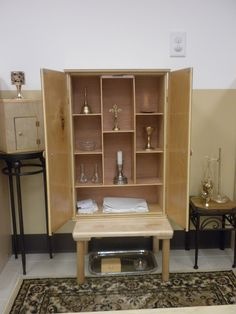 Altar and cabinet containing altar articles