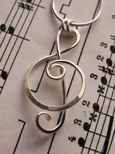 Treble Clef Pendant or Charm in Sterling Silver, Wire Wrapped Metalwork, Shiny