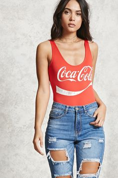 A stretch-knit pull-on bodysuit featuring a Coca-Cola logo on the front, a sleeveless cut, and a scoop neck and back.