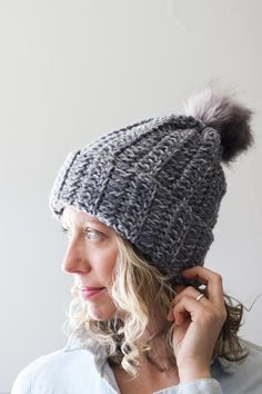 """This free beginner crochet hat pattern is a perfect example of how to make crochet look like knitting using simple double crochet stitches. Featuring Lion Brand Wool Ease Tonal yarn in the color """"Smoke."""""""