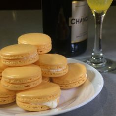 Mimosa macarons with champagne buttercream filling. Hell yes.