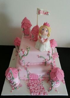 Princess castle first birthday cake completely edible with hadmade princess facebook.com/goldencakes