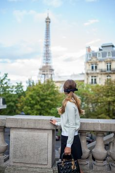 Dior handbag, overlooking the Eiffel tower in Paris.