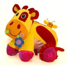 """Giggle Toys Patches The Huggable Cow, Yellow by giggletoys. $19.99. From the Manufacturer                """"I need a hug"""" patches the huggable Cow is a super soft, super sized huggable friend. Lots of areas to stimulate the senses. Sensual fabrics and a variety of sound elements to explore. Sitting up, standing up or sprawled out on all fours.... she is ready to be loved. It is appropriate from 6 months - 36 months."""