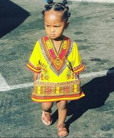 Dashiki print baby with bantu knot hairstyle