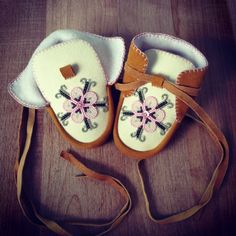 Baby slippers that I made from deer hide. I found the flower pattern here on Pinterest