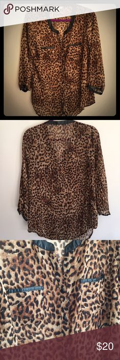 Cheetah top Sooo pretty and fun cheetah button up blouse!! Has sexy leather accents and buttons. *This is gently worn so may show signs of minor wear. I look all my items over and note any flaws that I notice. All my items are from a smoke free home. Charming Charlie Tops Button Down Shirts