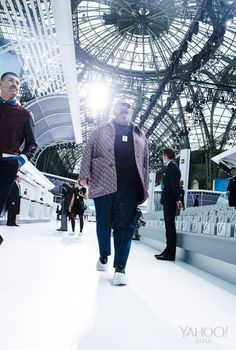 Michel Gaubert with his boyfriend, Ryan Aguilar, on set at the Chanel show before the guests arrive.