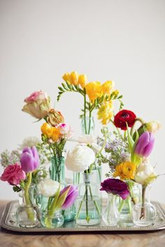 Spring Flowers // Single stems in vintage glass containers from Peaches and Mint