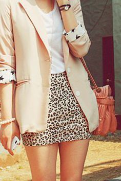 leopard skirt and pale pink blazer.