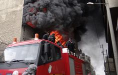 Firefighters attempt to extinguish a fire at a factory after what activists say was shelling by forces loyal to Syria's President Bashar al-Assad at al-Haidariah area in Aleppo, on February 8, 2013. (Reuters/Malek AlShemali)