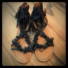 Black leather sandals with leather flower detail NEVER WORN leather sandals from Anthropologie. Double buckle closure and leather flower straps. Anthropologie Shoes Sandals