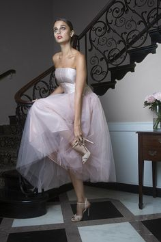 Heads will be turning in every direction as guests try to catch a glimpse of the elegant bride in Jane Summers' beautiful Blush Pink Tea Length Wedding Dress. The strapless Pink corset-inspired bodice paired with ballet-inspired layers of airy Blush Tulle practically guarantees gorgeous wedding photos.  #pinkweddingdress #weddingdress #tealengthweddingdress #tulle