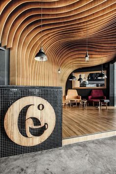 OOZN Design cover Indonesian cafe ceiling with undulating timber slats 6 Degrees Cafe in Indonesia by OOZN Design Design Café, Cafe Design, Store Design, Hotel Lounge, Commercial Design, Commercial Interiors, Timber Slats, Plafond Design, Interior Architecture