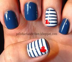 Navy blue mani and white & blue striped accent nails with tiny red hearts.
