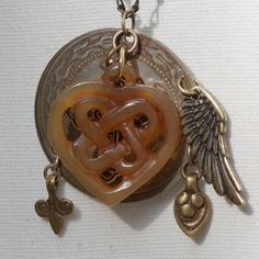 Carved Jade Heart Sacred Charm Necklace by TwoHeartArt on Etsy, $38.00