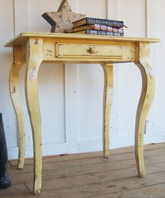 Cottage end table.  Artfully distressed and treated with a sweet yellow hue