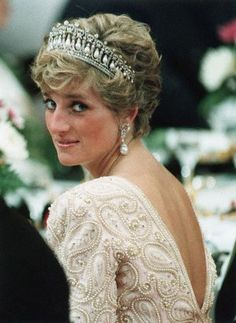 Diana, Princess of Wales looks over her shoulder and smiles during banquet for Japanese Emperor Akihito.Date Photographed:	November 12, 1990  Location Information:	Tokyo, Japan