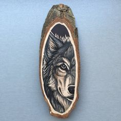 Wood slice with an original drawing of a wolf 'tattoo style', wall decoration