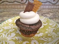 Sweet Tooth Sisters: S'more Cupcakes.  Frosting:  Beat together butter and vanilla. Add the powdered sugar and beat until fluffy. Add the jar of marshmallow creme and beat to combine. Frost the cooled cupcakes. I decorated them with hershey bar and graham cracker, but that is optional. Enjoy!