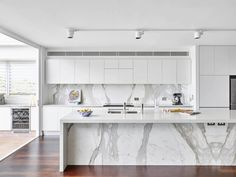 Modern Kitchen Interior Remodeling 30 Gorgeous Grey and White Kitchens that Get Their Mix Right - Designing your kitchen in grey and white need not produce a sterile look. Grey cabinets, white counters, and gray wood floors can create a warm look. High Gloss Kitchen Cabinets, Modern Kitchen Cabinets, White Cabinets, Kitchen Island, Kitchen Modern, Modern Kitchens, White Counters, Floors Kitchen, Kitchen Ideas