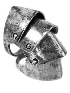 http://gypsywarrior.com/collections/whatisnew/products/armor-ring    Armor Ring    Brushed silver, lightweight knuckle ring with moveable hinges and two rings.