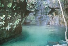 Pool deep inside a cave, Madagascar (natural opening/skylight above!)