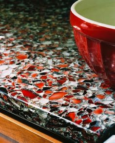 Recycled glass countertop ~ not certain of the cost, but I love the idea!!