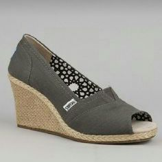 TOMS wedges Sz 11 EUC Worn twice. Also selling a blue and ivory patterned pair in 11. Grey with tan colored rope wedge. Rubber soles are excellent.  Open to offers! TOMS Shoes Wedges
