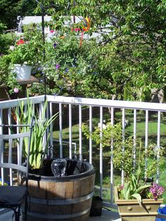 Deck Fountain.. Does anyone have any easy DIY pond ideas for small spaces - decks and balconies? This is one I had many years ago on our deck, with fish in it. A half barrel with a thick plastic liner, small pump and a few plants ,it was very cute